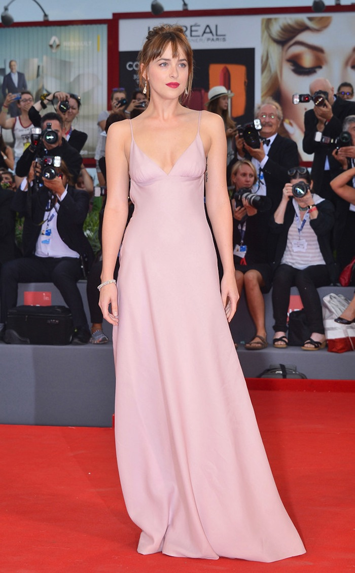 Dakota best dressed in Prada on the red carpet of Venice Film Festival